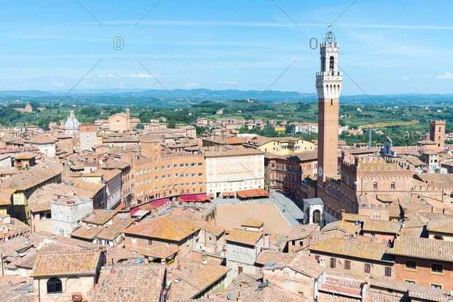 August 29, 2015: Cityscape view of rooftops and Torre del Mangia, Siena, Tuscany, Italy
