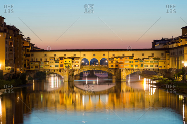 August 31, 2015: Ponte Vecchio bridge over Arno river at dusk, Florence, Tuscany, Italy
