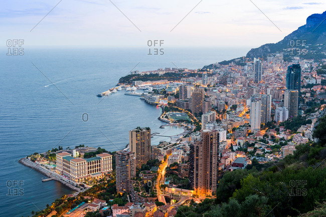 Coastal cityscape with skyscrapers and hotels at dusk, Monaco