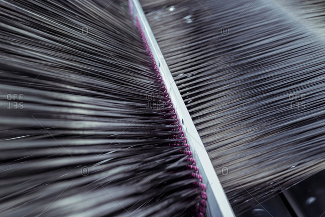 Carbon fibre thread on loom in carbon fibre production facility