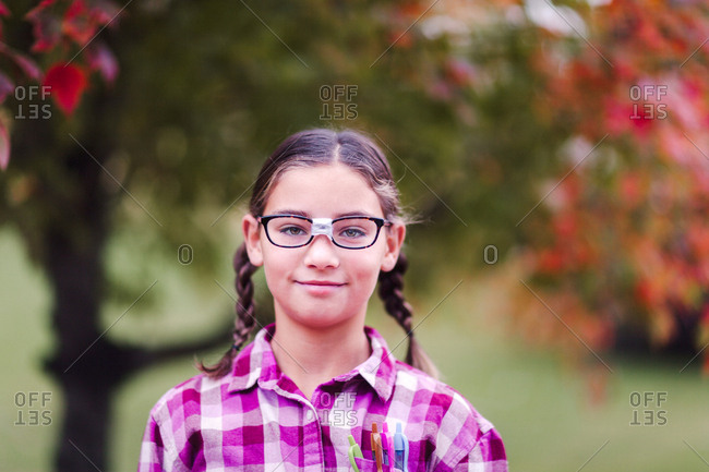 Girl with plaits and broken glasses dressed up as nerd