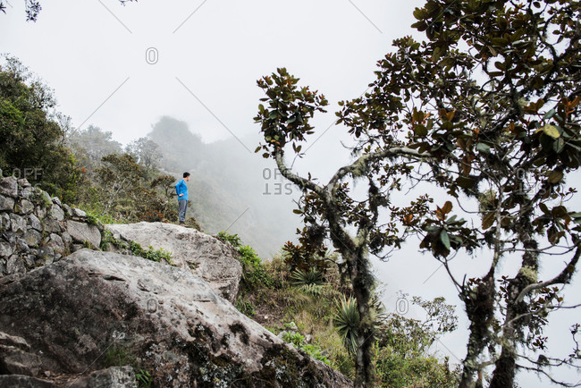Man hiking up Machu Picchu Mountain at Machu Picchu, Peru