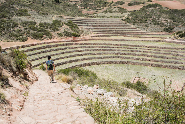 Man exploring Moray Ruins in Maras, Cusco, Peru, South America