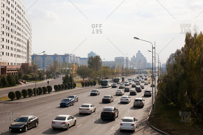 Cars on dual carriage way in busy street, Astana, Kazakhstan, Asia