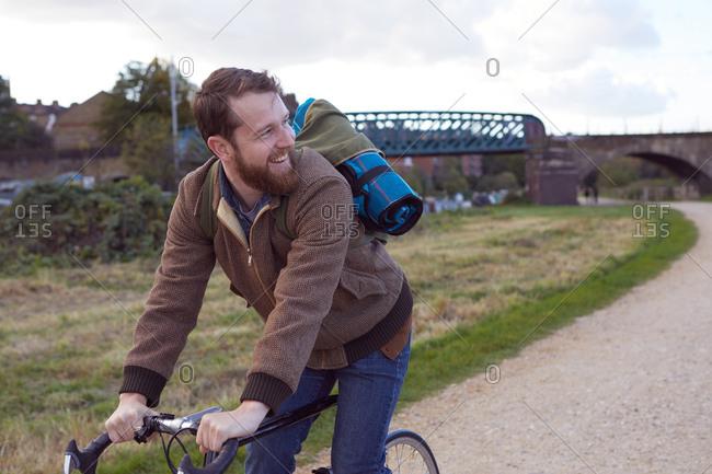Man cycling on path