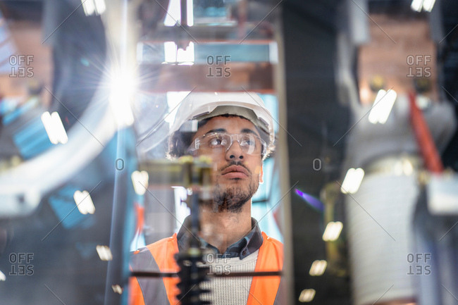 Portrait of apprentice in workshop of railway engineering facility