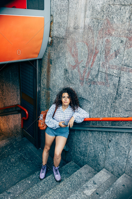 Woman at bottom of stairs, Milan, Italy