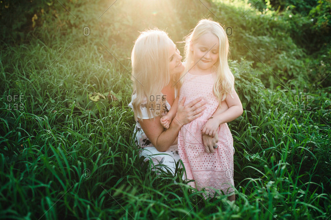 Mother and daughter in tall grass