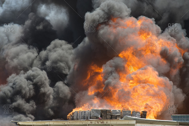 Smoke emitting from burning crates in factory