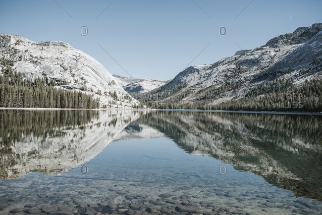 Symmetry view of lake by mountains against clear sky at Yosemite National Park