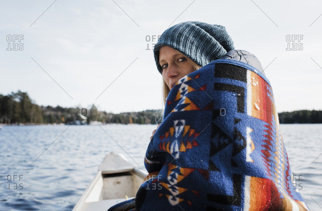 Portrait of woman traveling in boat on river against sky