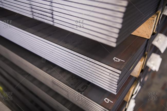 Close-up of sheet metals arranged at warehouse