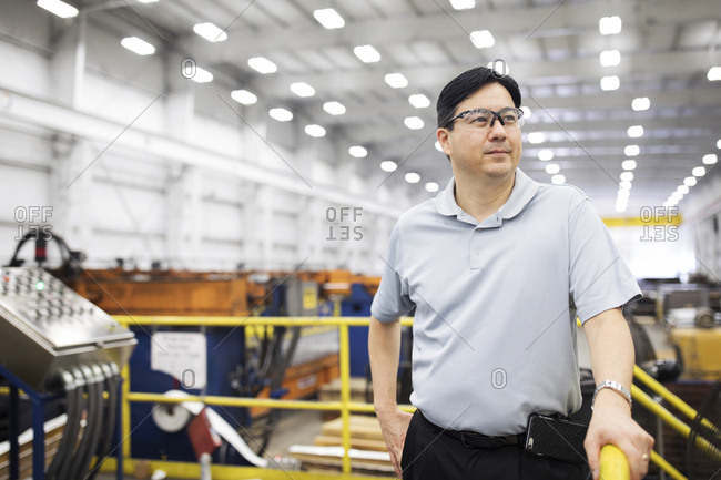 Confident supervisor looking away while standing in Steel Industry Factory