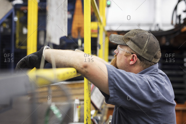 Side view of worker in Steel Industry Factory