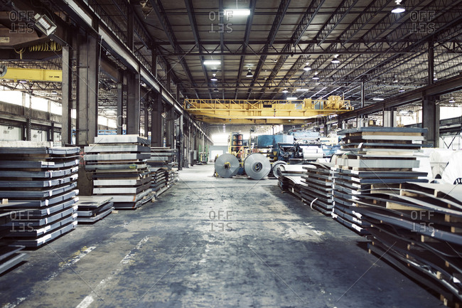 Metal sheets and machineries in warehouse