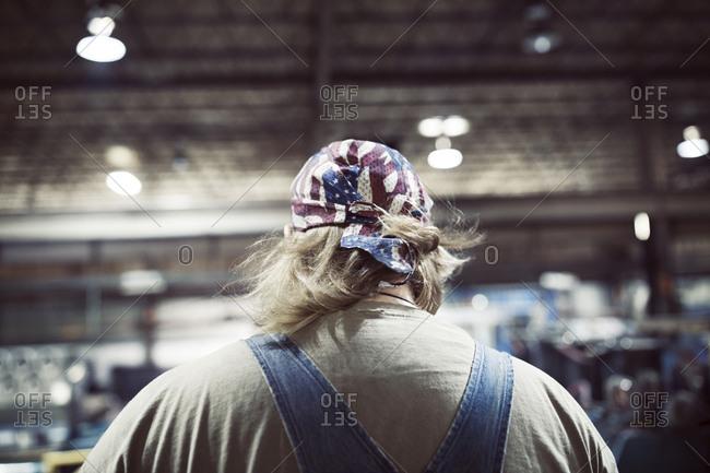Rear view of blue collar worker in steel industry