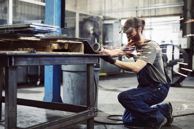 Welder working in steel industry