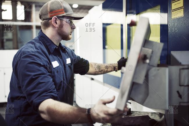 Manual worker using desktop computer in steel factory