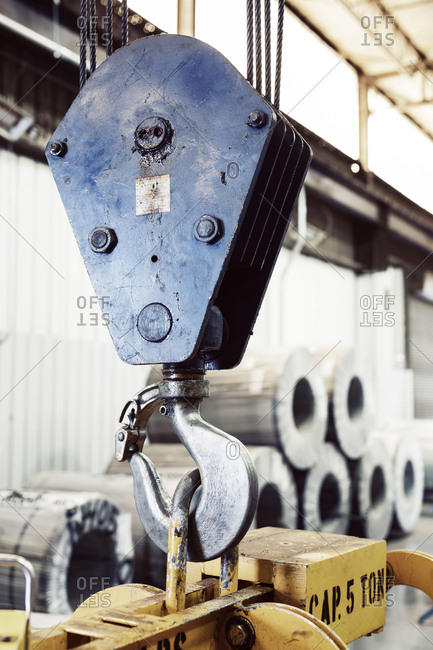 Close-up of hook over machine at industry