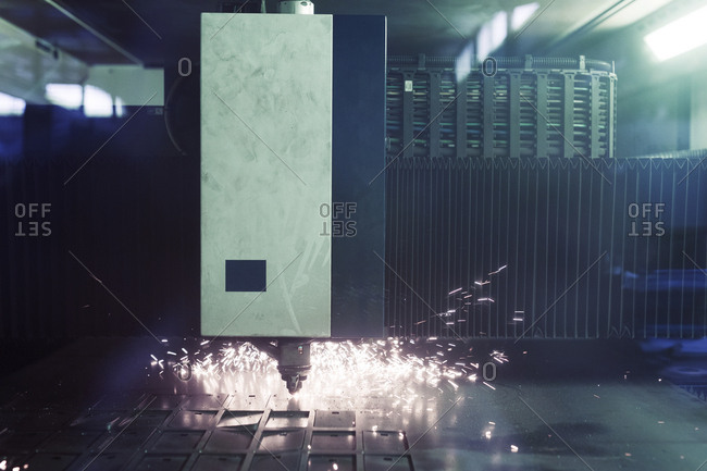 Sparks emitting from machinery in factory