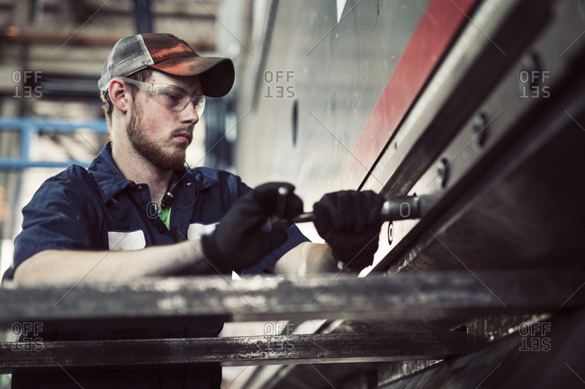 Low angle view of man working in steel industry