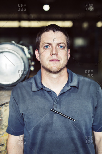 Close-up portrait of worker standing in industry