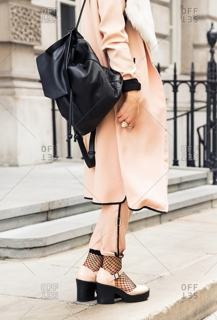 London, England - February 28, 2015: Stylish woman wearing peach colored outfit