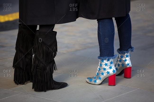 London, England - February 29, 2016: Two women wearing fashionable shoes