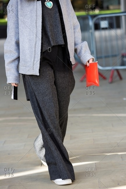 London, England - February 29, 2016: Woman wearing gray fleece outfit