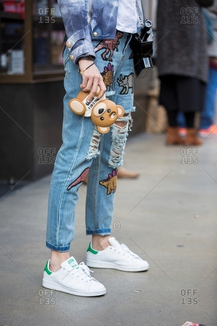 London, England - February 29, 2016: Stylish woman wearing jeans with sequin dinosaurs