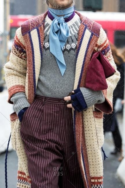 New York - February 29, 2016: Stylish man wearing sweaters and stripes slacks