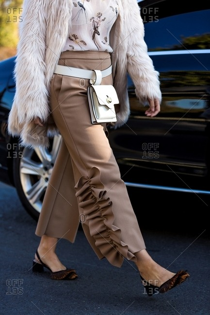 Paris, France - October 10, 2015: Woman wearing stylish tan outfit and fur coat