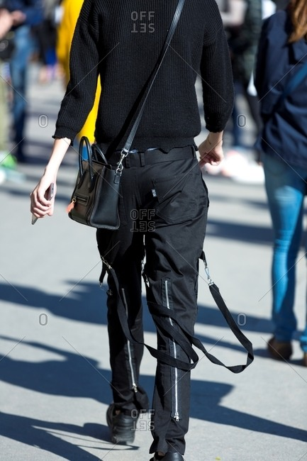 Paris, France - October 10, 2015: Person dressed in all black with straps on their pants