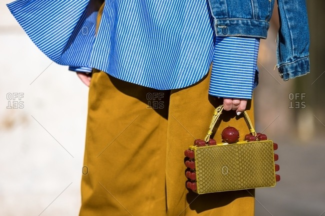 Paris, France - October 10, 2015: Close up of fashionable woman holding designer purse