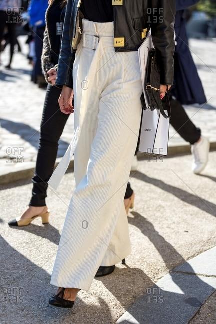 Paris, France - October 10, 2015: Fashionable woman walking down streets of Paris