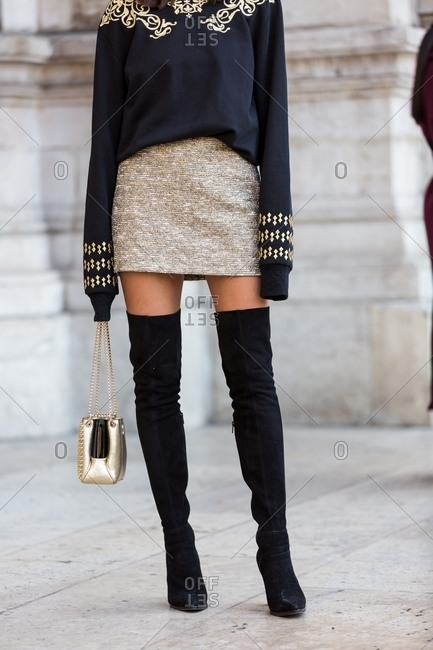 Paris, France - November 4, 2016: Fashionable woman wearing black and gold outfit