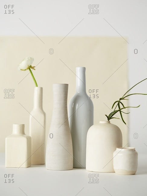 Pale bottles and vases on display