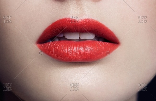 Close-up of mouth with red lipstick
