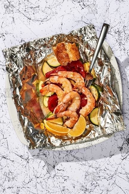 Shrimp dish in foil from above