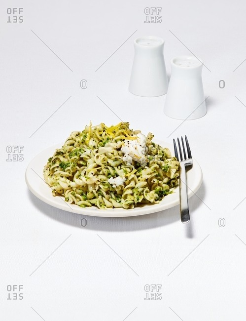 Healthy dish of noodles with pesto sauce