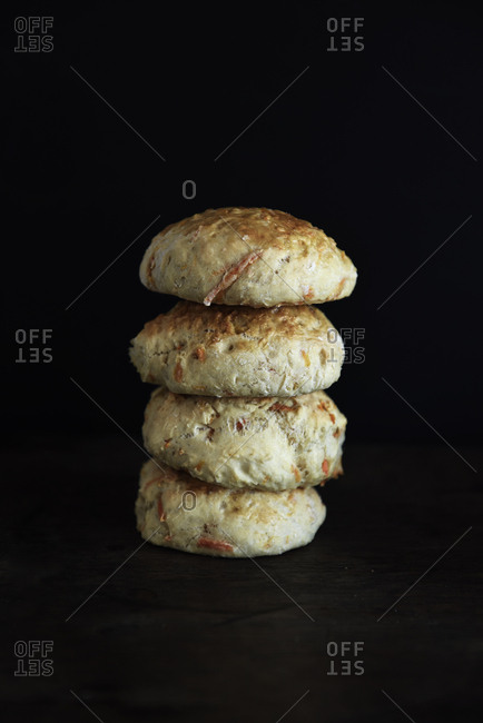 Stack of bread rolls on a dark background