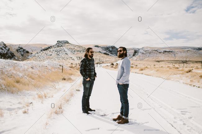 Men standing in snowy road