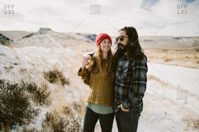 Couple looking at snow on hills