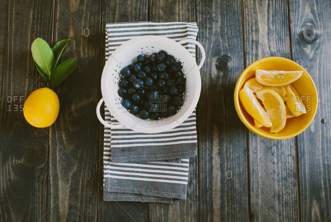 Blueberries and lemons on the table