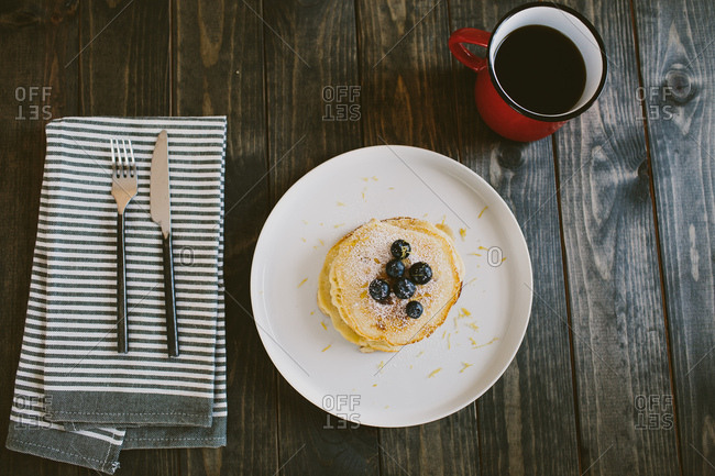 Blueberry pancakes and coffee breakfast table