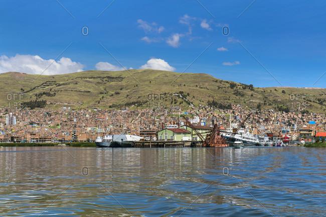 Puno, Puno, Peru - May 7, 2017: Puno town on Peruvian shore of Titicaca lake, Peru