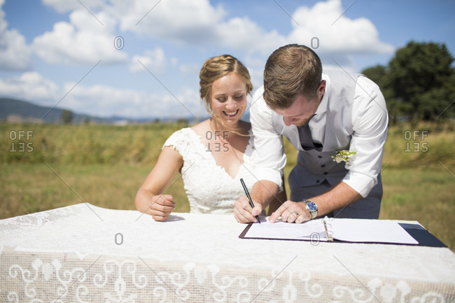 Bride and groom signing marriage license, Abbotsford, British Columbia, Canada