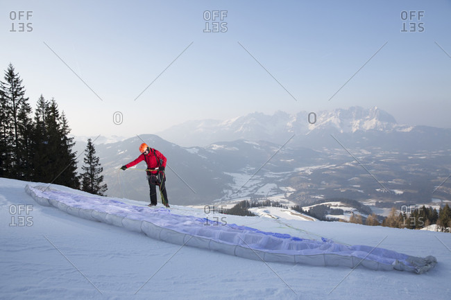 Man preparing before speed flying in Austrian Alps, Kitzbuhel, Tyrol, Austria
