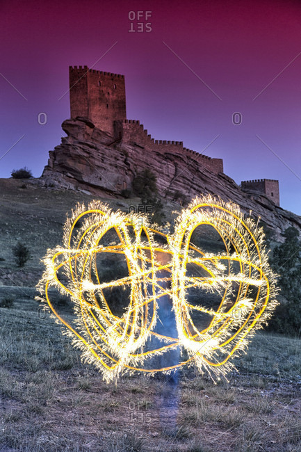Light painting in front of Castle of Zafra, Campillo de Duenas, Guadalajara, Castilla La Mancha, Spain