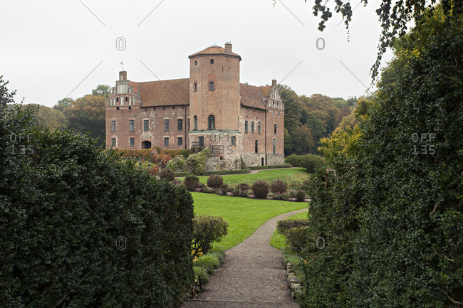 Bara, Sweden - October 15, 2017: Torup Castle seen through path lined with hedges